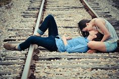 kissing on the train tracks