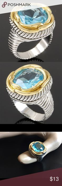 Blue Topaz Large Statement Ring Yellow & White Gold high polish layered, 2.25ctw Blue Topaz Large Statement Ring. White gold plated. Size 7. The first 2 pictures are stock photos, the others are of the actual Ring. New. Never been worn. Jewelry Rings