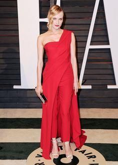 Diane Kruger in a re     Diane Kruger in a red silk crepe draped one shoulder gown over red cigarette pants at the 2015 Vanity Fair Oscar After-Party