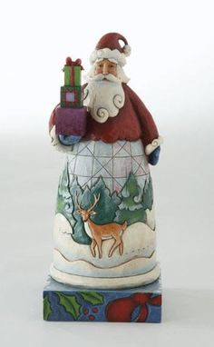 """Jim Shore Heartwood Creek Christmas Collection  Santa with Gifts  This beautiful piece makes a perfect gift or table decor item. Highly detailed figurine features colorful quilt patterns and a handcrafted look.     Measures: 7"""" H  Materials: Stone Resin  Note: Unique variations should be expected; hand painted.    Your Price: $20.00"""