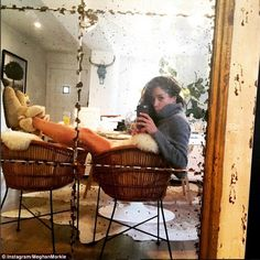 Uggs, orange juice and a cowhide rug on the floor. Meghan snaps a selfie in the distressed mirror displayed in her dining room
