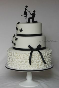 With ruffles, butterflies and 'On bended knee' cake topper.