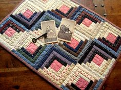 Log cabin doll quilt from book Prairie Children & Their Quilts by Kathleen Tracy www.countrylanequilts.com