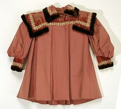 Child's pink wool dress with silk velvet collar and cuffs and brown fur trim, American, 1890. Worn with matching pink silk bonnet with brown fur trim.
