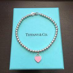 "Tiffany's Bead Bracelet Return To Tiffany Bead Bracelet. Size Large: 7.5"" long. Sterling Silver. Mini heart tag with pink enamel finish. Tiffany & Co. Jewelry Bracelets"
