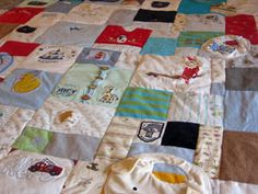 Baby quilt made with first clothes, hats, bibs.   O wow I've always wanted to do with the girls baby clothes.