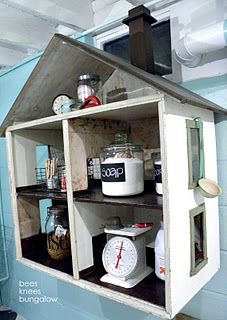 Dollhouse in the laundry room.  So cute !