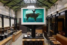 """""""Tramshed"""" restaurant in Shoreditch (London), with a custom commissioned artpiece by Damien Hirst as the centerpoint."""