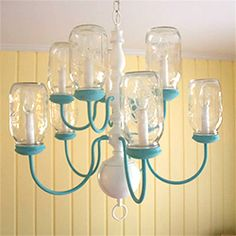 Fabulous mason jar chandelier created from outdated brass chandelier with cloth shades. Marvelous makeover!