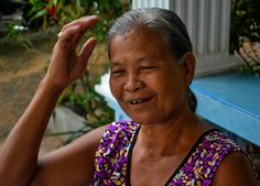 Rural granny with black teeth and gums. Chewing Betel Nut in Rural Thailand Isaan with gummy old grannies. Ingredients of betel chewing include Areca nut, betel leaf and sandstone paste. Traditions and Culture in rural Thailand (Isaan) by http://potatoinrice.com/