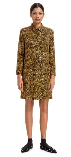 BIMBA Y LOLA short dress with Speed Leopard print, a design featuring orange-toned animal print against a black background. Shirt model cut at the waist with front button fastener.  Detail  Standard fit Shirt collar Long sleeves Button fastener