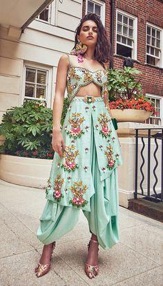 Dhoti jumpsuit embellished with glass beads, neon sequins, enamel stones and metallic charms. Salwar Designs, Kurti Designs Party Wear, Designer Party Wear Dresses, Indian Designer Outfits, Designer Ethnic Wear, Stylish Dresses, Fashion Dresses, Stylish Dress Book, Choli Dress