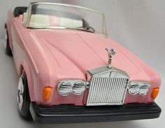 Pink Rolls Royce Barbie convertible from the 80's.  I still have mine and my kid owns it now! awesome!