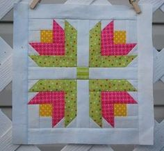 Log Cabin Flower - I like this block - may have to try it.