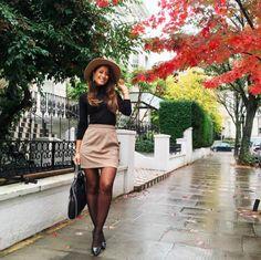 Mimi Ikonn | Black long sleeve blouse, tan skirt, black Stella McCartney Falabella shoulder bag, pointed heels, hat, statement earrings | OOTD