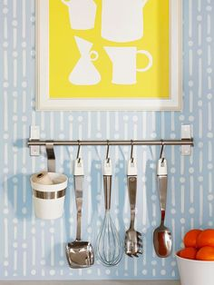 Keep cooking utensils close by with a metal rod and S hooks. More low-cost kitchen updates: http://www.bhg.com/kitchen/remodeling/planning/low-cost-kitchen-updates/?socsrc=bhgpin073012hangingkitchenutensils#page=14