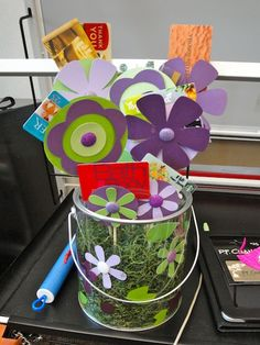 Our room mom made this for a teacher gift last year - using a Cricut to cut out the flowers then added gift cards from the class.  Too cute!