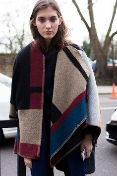 Emma Waldo wearing her @Burberry cape post show.