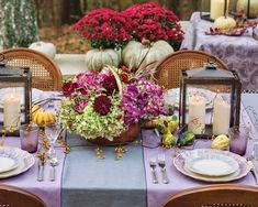 A tabletop scheme of aubergine and amethyst complement the warm notes of autumn leaves. Weathered lanterns filled with flickering candles cast a dreamy glow, while scattered gourds hint at the flavorful harvest meal to come. #southernladymag #tabletopinspo #purpletabletops #tablescapes #floralinspo #floralarrangement #mums #pumpkins #eleganceintheeveryday #autumntablescapes #autumnentertaining #diningalfresco #outdoorentertaining #replacementsltd