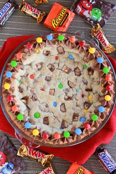 A giant cookie filled with candy bars, baked in a pie dish and topped with chocolate frosting.