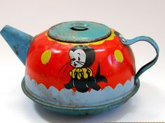 antique toy teapot with circus motif