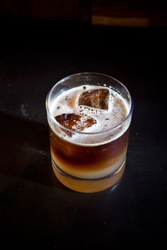 Sailor's Ale: 1/2 oz Morris Kitchen Ginger Syrup, 1 1/2 oz Sailor Jerry's Rum, 1 oz lime juice, splash of dark beer. via Design*Sponge.