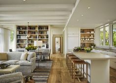 South Shore Decorating Blog - open plan space, built in shelving, contemporary kitchen in a country style home.  This makes me think I could have a contemporary kitchen in our house.
