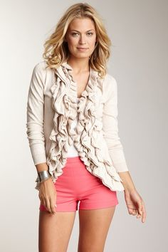 Spice up your basics with this ruffle embellished cardigan sweater.
