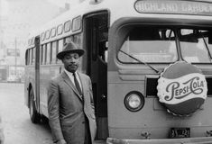 King stands in front of a bus as the end of the Montgomery bus boycott | photo: bettman/corbis