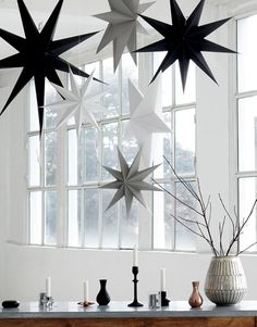 White Cardboard Hanging 9 point Stars to hang alone or in clusters. Lovely Scandinavian Christmas Decorations from House Doctor at Design Vintage.