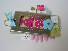 mimi album using a light switch plate cover.