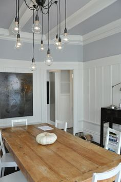 I would love to raise the wainscoting to this height in the dining room and add beams!