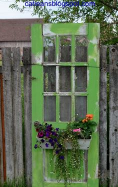 Reusing Old Doors - I Have had these old doors in the wood pile for too many years. Finally slapped on some outdoor paint attached repainted plastic plantar box…. Old Door Projects, Garden Projects, Garden Ideas, Garden Doors, Garden Gates, Recycled Door, Repurposed Doors, Recycled Windows, Old Screen Doors