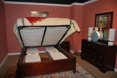 Durham Furniture -- New Under Bed Storage Solution.  Great idea! http://www.thehome.com/small-spaces-to-overscaled-opposites-attract/ #hpmkt