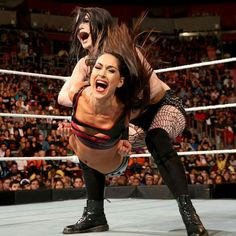 Paige giving Brie Bella PTO aka Paige Tap Out
