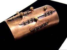 """Art Smith. Bracelet Cuff Copper and brass.  ca. 1946. One of the leading modernist jewelers of the mid-twentieth century, Smith trained at Cooper Union. Inspired by surrealism, biomorphicism, and primitivism, Art Smith's jewelry is dynamic in its size and form. Although sometimes massive in scale, his jewelry remains lightweight and wearable. See """"From the Village to Vogue: The Modernist Jewelry of Art Smith""""."""