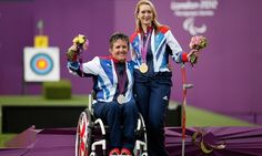 Danielle Brown and Mel Clarke of Great Britain pose with their gold and silver medals respectively in the women's individual compound open archery competition at The Royal Artillery Barracks.