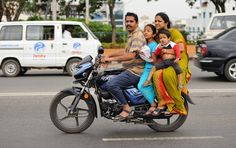 Transportation: This is a picture of a family of four riding a motorcycle. There aren't many motorcycle riders in India. 10% of households in India actually own a motorcycle. Transportation is a major part of India's economy.