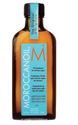 Moroccain Oil, smells great and excellent for dry/damaged hair. Use in wet hair and before applying heat.