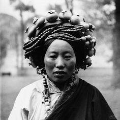 """Zhuang Xueben, a Chinese photographer created an extensive and beautiful record of Western China's remote outreaches in the 1930s.   1934至1942年,庄学本在四川、云南、甘肃、青海四省少数民族地区进行了近十年的考察。在这期间,庄学本拍摄了万余张照片,写了近百万字的调查报告、游记以及日记。 庄学本的摄影考察从一开始就专注于那些""""白地""""(地图没有之地),他的目光从社会组织。生产方式,贸易到自然生态,文化。宗教,习俗等,几乎囊括了整个社会形态。 当他拍摄一个人的肖像时,他会同时拍摄正面,侧面,背面,显然,他是对一个民族从人种到服饰的记录。难得的是他的目光不仅有平民,还有统治阶级和贵族,不仅涉及当地的生活形态婚丧嫁娶,还涉及税收制度与教育。他不是猎奇者,而是一个态度严谨,工作深入的考察者,他不是一个居高临下的入侵者,他努力地融入当地人的生活,在情感上走近他们,从精神层面认识他们。"""