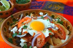 Mexican Chilaquiles with Eggs and Black Beans in either red or green enchilada sauce are a favorite brunch item from south of the border.