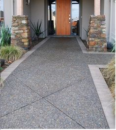 Exposed aggregate concrete is perfect for driveways and paths; polished concrete floors and bench tops for indoors. Each region has its own exposed concrete offering. You can add glass, shells or colours for a unique designer concrete look. Concrete Patios, Concrete Pathway, Concrete Patio Designs, Cement Patio, Cement Driveway, Driveway Border, Exposed Aggregate Driveway, Exposed Concrete, Diy Patio