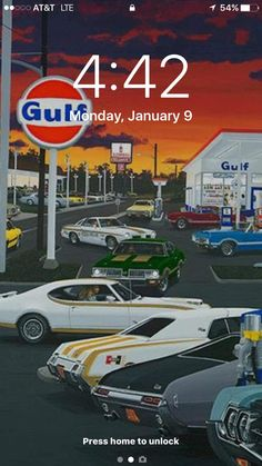 Vintage Gulf station with Olds dealership in background and Hurst / 442's with lock screen snapshot at 4:42!