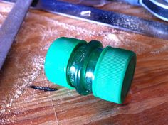 Plastic Soda Bottle Lid Capsule. A small water-tight container with two ends that can be open via the lids. The total weight of the container is 0.5oz and it took about 10 minutes to make including the time to let the glue set. Would be a great geocaching container.