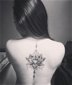 Image result for lotus flower spine tattoo
