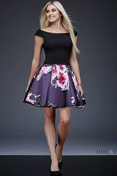 Off-the-shoulder black and multi fit and flare dress with a printed skirt. 77e37b383