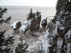 Winter at Hopewell Rocks, New Brunswick, Canada. Love this. winter pic. We never see that.