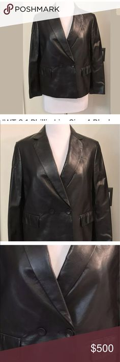 """3.1 Philip Lim leather blazer jacket New with tags 3.1 Phillip Lim 100% soft leather Black Fully lined Size 4 It's a short blazer. The size makes it look current and not classic or dated!   Measurements (flat/unstretched) Under arms across back  17.5"""" Under collar to hem down back 22"""" around bottom hem 39""""  21"""" from shoulder to end of sleeve   All of my items are guaranteed to be authentic. 3.1 Phillip Lim Jackets & Coats Blazers"""