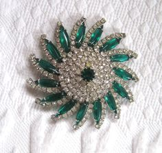 Emerald Rhinestone Brooch / Pinwheel Emerald Brooch / by vintagous on Etsy