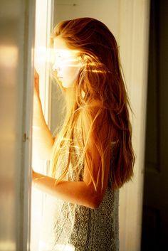 girl opens door, light, sunshine
